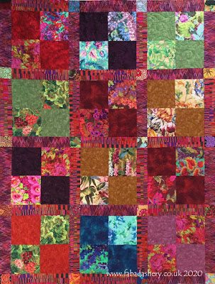 Quilt made by Jennie. Kaffe Fassett Collective fabrics.
