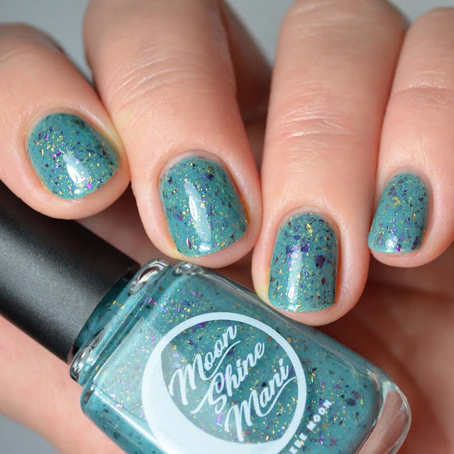 teal nail polish with flakies four finger swatch