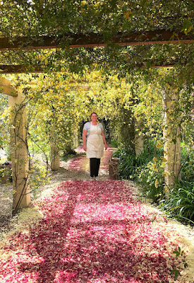 Flower farmer on a peony petal pathway, a great idea for parties