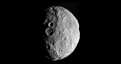 A last look back at Vesta: This image is from the last sequence of images the NASA Dawn spacecraft obtained of the giant asteroid Vesta, looking down at Vesta's north pole as it was departing. Photo Credit: NASA
