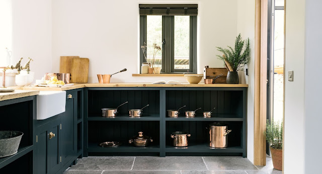 Gorgeous modern country kitchen with dark blue cabinets - found on Hello Lovely Studio