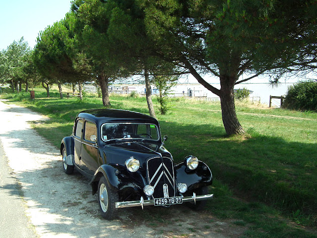 Citroen Traction Avant and Fishing huts, Charente-Maritime, France. Photo by Loire Valley Time Travel.