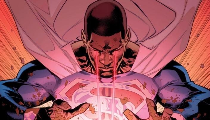 Imagem: ilustração dos quadrinhos com o personagem Val-Zod, um Superman Negro, com uma capa prateada e um uniforme azul com um símbolo de um S prateado em um diamante vermelho, usando a sua visão de calor, e lançando raios vermelhos a partir dos seus olhos.