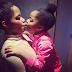 Edge Nigeria: Amara Kanu gives her baby girl loving kisses (photos)