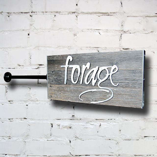 Custom sign made from reclaimed wood and steel for a Vancouver restaurant