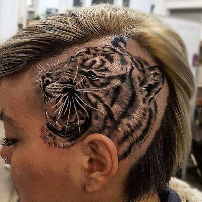 tatuaje de un tigre en la cabeza rapada