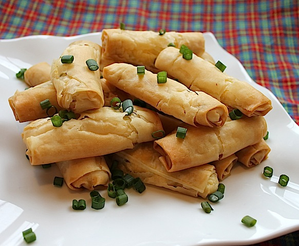 Food Lust People Love: Crispy, crunchy filo pastry baked around a lovely green onion, feta and ricotta cheese filling makes these little filo cheese rolls the perfect snack.