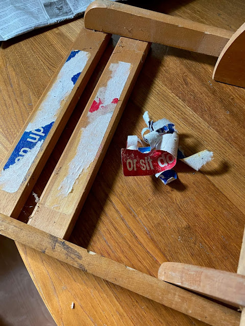 Photo of removing a sticker on a folding chair/step stool