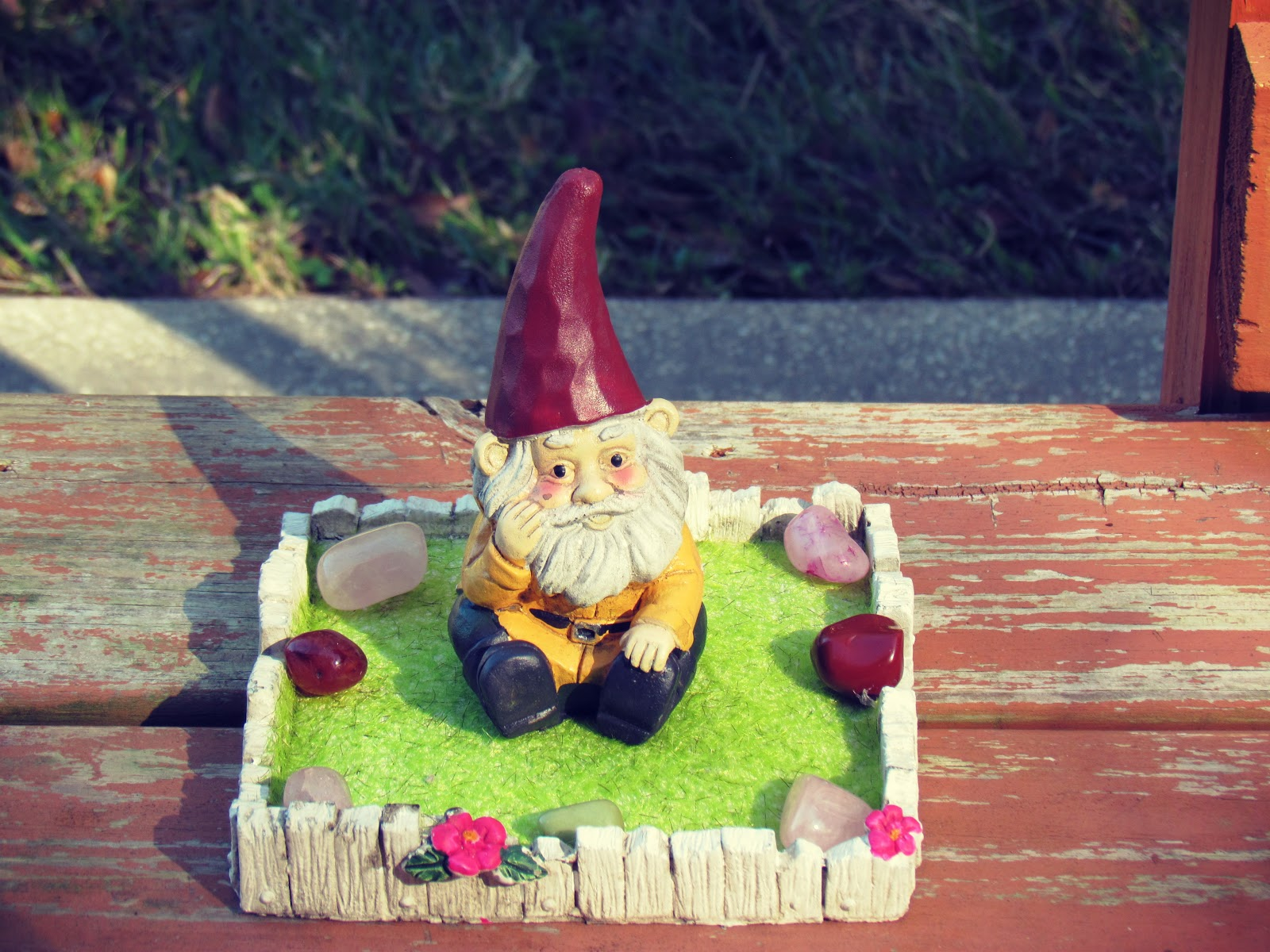 A gnome zen garden sitting on the back porch in a natural setting in sunny, tropical Florida