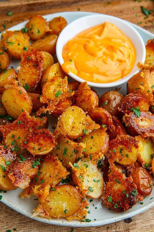 Potatoes roasted with parmesan cheese that get all sort of nice and golden brown, crispy and good! Seriously better than french fries!