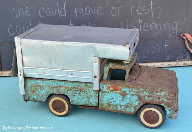 rusty turquoise Tonka truck with camper