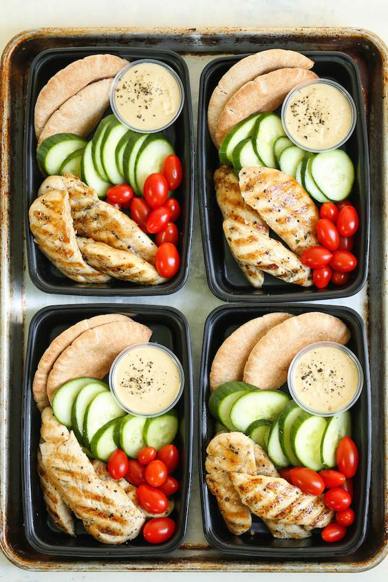 Meal prep for the week ahead!!! Filled with hummus, chicken strips, cucumber, tomatoes and wheat pita.