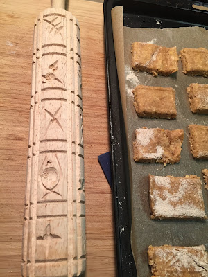 Springerle rolling pin and unbaked dog biscuits
