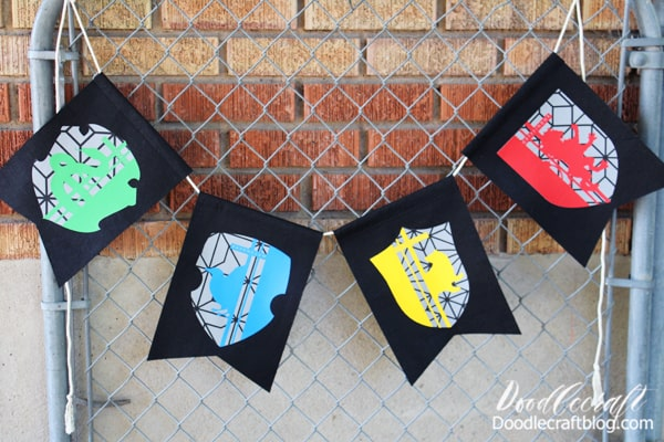 his fabulous bunting/banner with the house crests is super simple to make! Yes, it requires a few specialized supplies...but the options are endless if you have a Cricut.