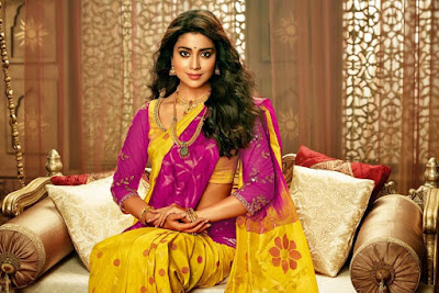 Shriya Saran in purple and yellow color saree