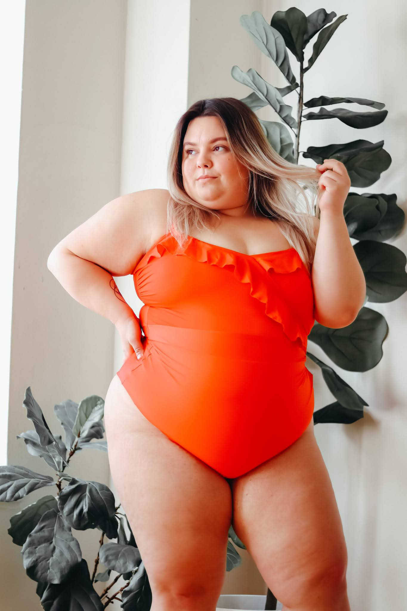 Chicago Plus Size Petite Fashion Blogger, influencer, YouTuber, and model Natalie Craig, of Natalie in the City, searches for sexy, confidence-boosting plus size one pieces two pieces and swimsuits.