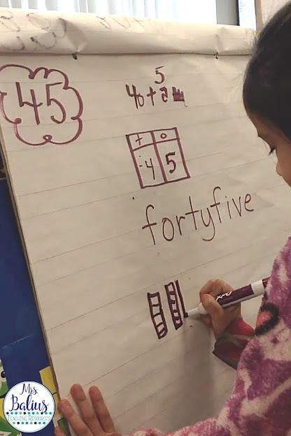 students working on breaking down the number 45 as part of number of the day