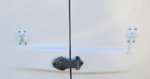 trailer door holdback