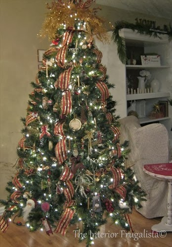 Christmas tree decorated with cherished ornament exchange embellishments