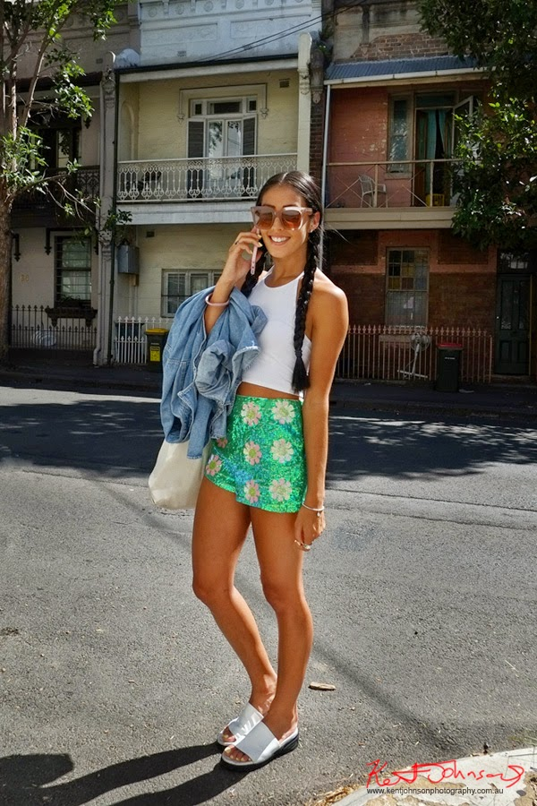 Street Fashion Sydney, green sparkle shorts with flower motif, white halter-neck top and a denim jacket. Photo by Kent Johnson.