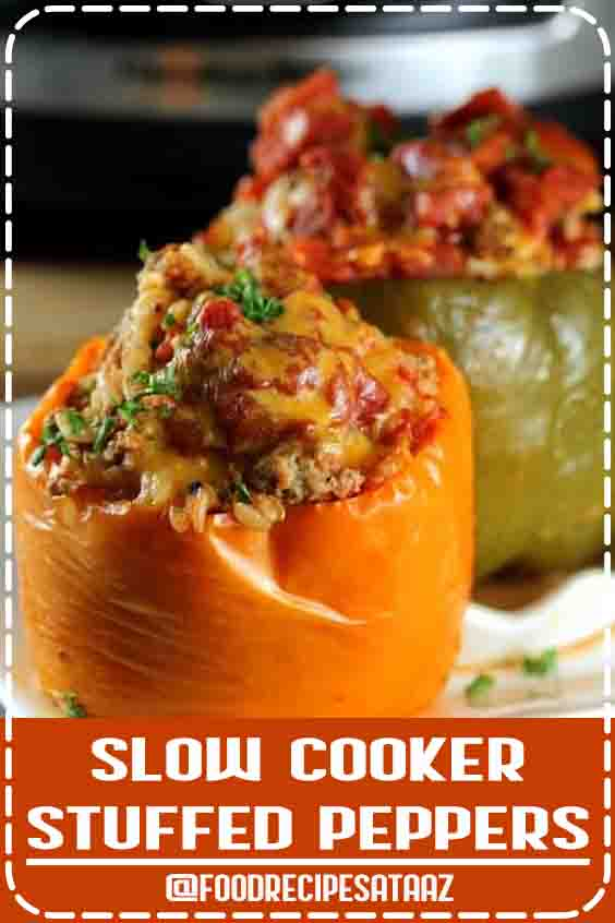 4.8 ★★★★★ | Tender Bell Peppers filled with a beef, rice and tomato filling and cooked to perfection in the slow cooker. #SlowCooker #StuffedPeppers #DamnDelicious