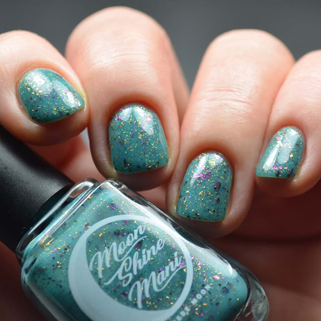 teal nail polish with flakies four finger swatch low light