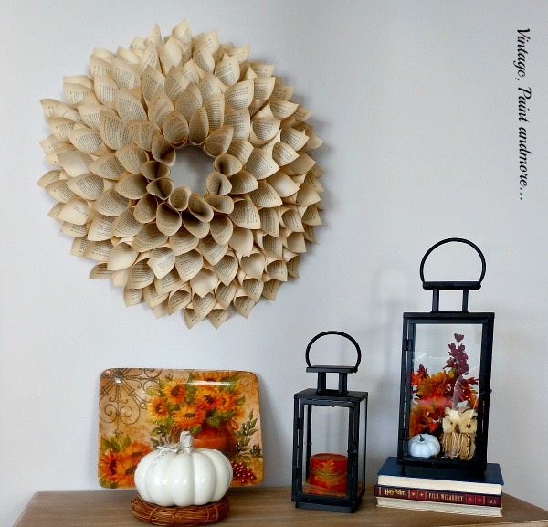 Vintage, Paint and more... book page wreath displayed in a fall vignette