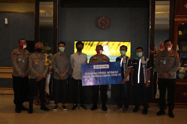 Polda lampung terima bantuan dari Danone Indonesia.