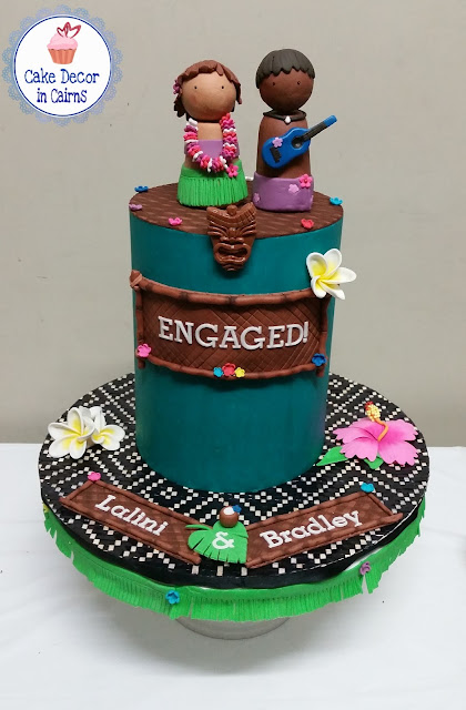 Teal Coloured Ganache Luau Tiki Hawaii Engagement Cake Edible Toppers Tropical Flowers