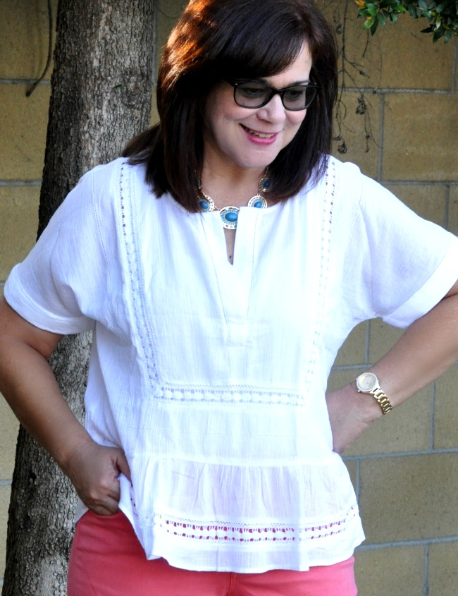 white cotton blouse and statement necklace