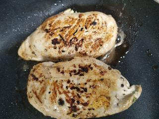Chicken breasts grilled on pan for healthy chicken parmesan recipe