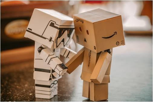 Two robots made of boxes - a great way to include your kids in the moving process