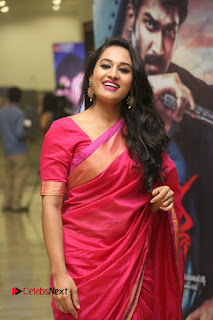 Actress Pooja Ramachandran Pictures in Red Silk Saree at Siddhartha Audio Release  0100.JPG
