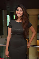 Priya Vadlamani super cute in tight brown dress at Stone Media Films production No 1 movie announcement 049.jpg