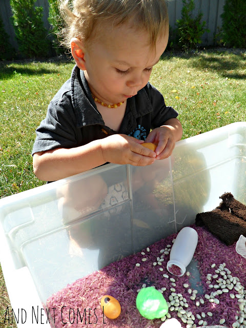 Toddler playing with a Gruffalo inspired sensory bin