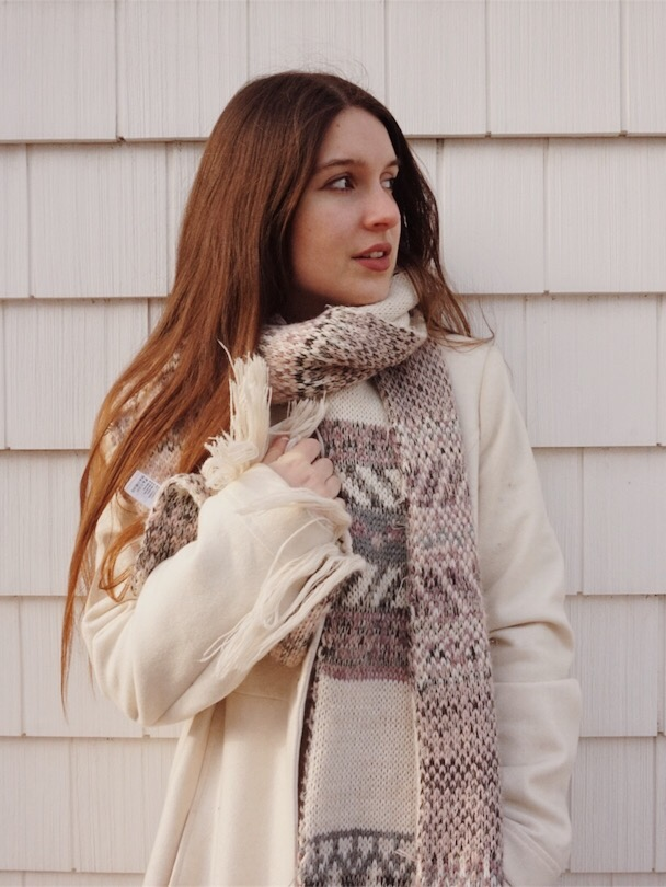 portrait of a brunette girl wearing a chunky scarf