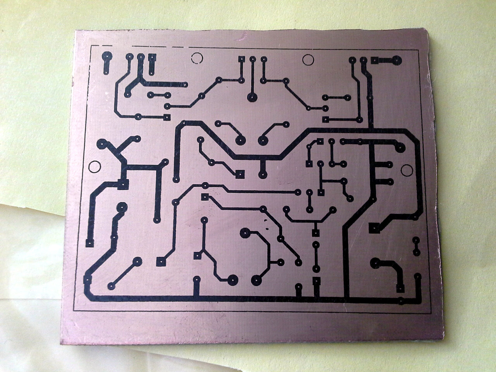 Homemade Pcb With Toner Transfer Method One Transistor Circuit Board After Etching Process Peeling Off The Paper Print On Copper