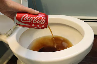Coca-Cola in toilet bowl