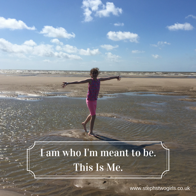 girls on beach with arms wide and text I am who I'm meant to be. This Is Me.