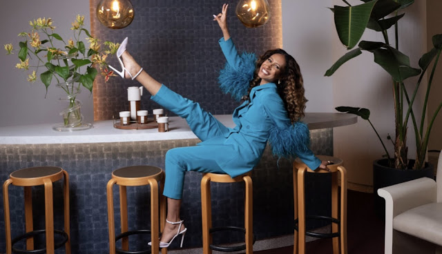 Elaine Welteroth wearing turquoise power suit for Masterclass
