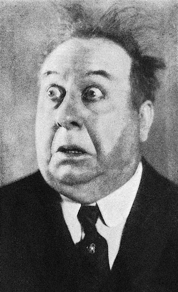 a photograph of film comedian Mack Swain overacting for laughs, shock, fear, surprise