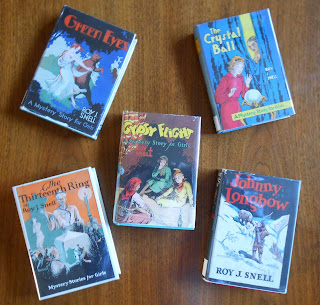 Image of five Roy Snell books from the collection