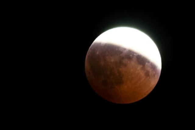 Partial Lunar Eclipse Centered Over Jerusalem Appears