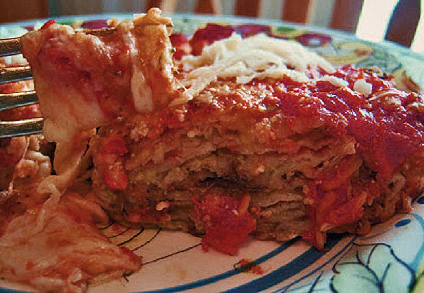 This is an Italian baked casserole sliced eggplant with tomato sauce, Parmesan Cheese and shredded layers of Mozzarella and eggplant called Eggplant Parmesan