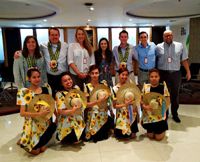 Guest of Honors during the Accenture client meeting wearing our Philippine-inspired rosette ribbon lei