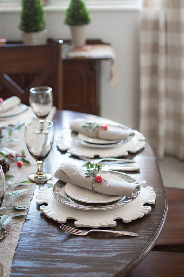 table set for Christmas with vintage dishes, natural and rustic decor