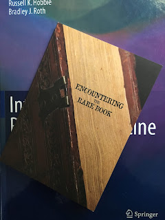 Ecountering the Rare Book, an exhibition celebrating the Special Collections in Kresge Library at Oakland University, organized by Andrea Eis, superimposed on Intermediate Physics for Medicine and Biology.