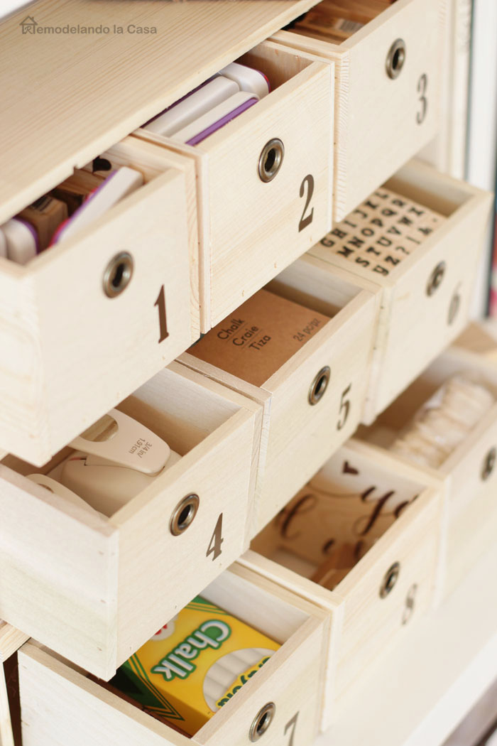 numbered wooden drawers storing stamps, chalk, tags, hole punchers