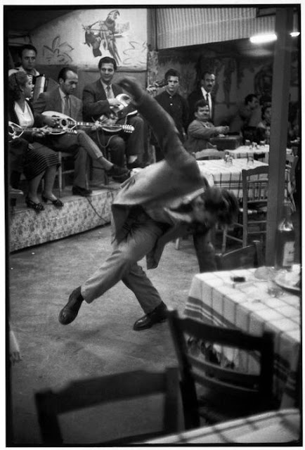 Zeibekiko dancer.  Henri Cartier Bresson Cafe Piraeus.Greece 1953