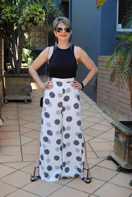 BLACK AND WHITE POLKA DOT JUMPSUIT